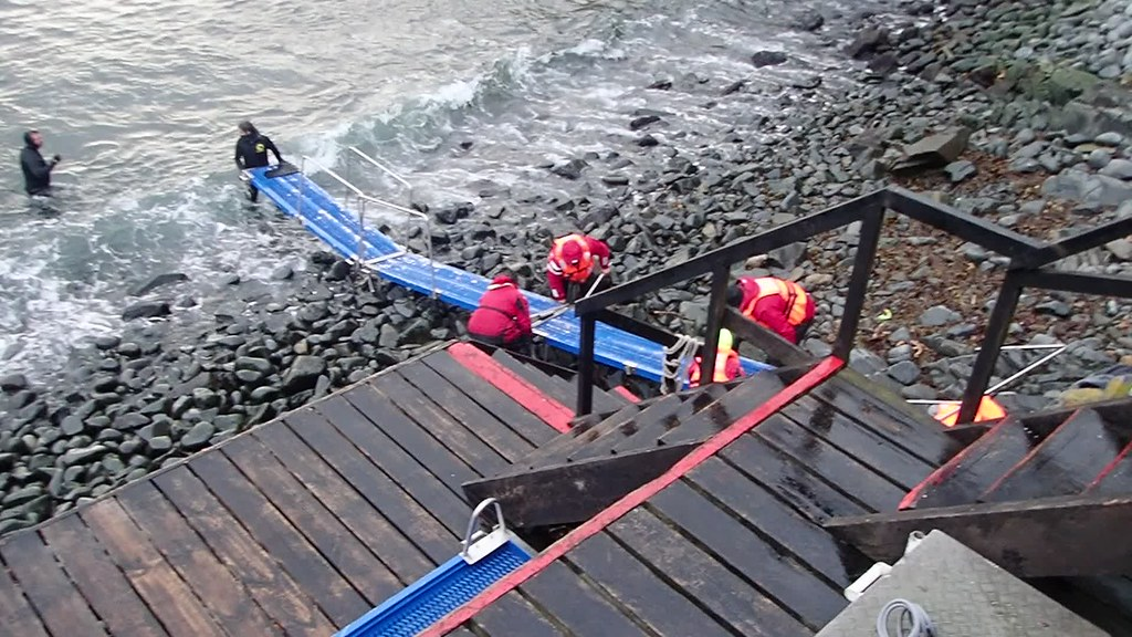 The Ventus Australis expedition team working in pretty rough conditions on Cape Horn Island to prepare a ramp so that they can take visitors to the island back to the ship on the waiting RIBs