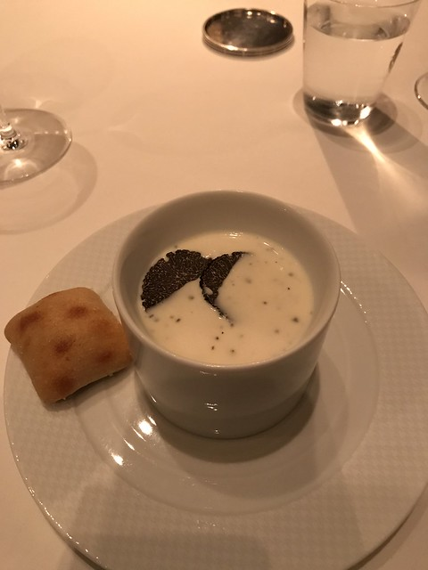 Celery root veloute with smoked duck and winter truffles