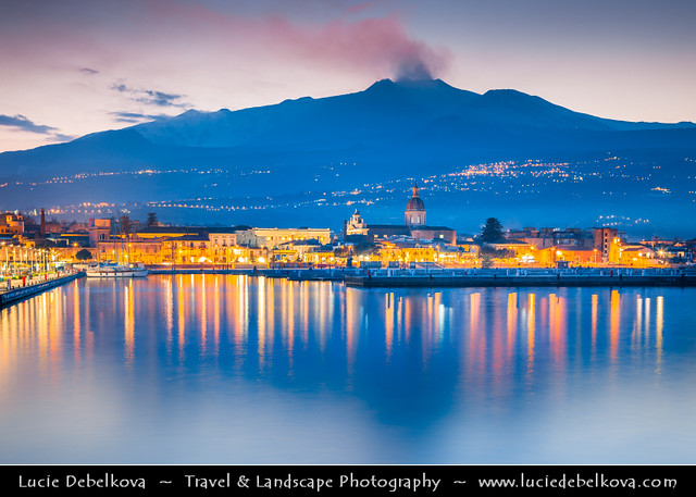 Italy - Sicily - Riposto fishing town under active Etna Volcano at Twilight - Dusk - Blue Hour