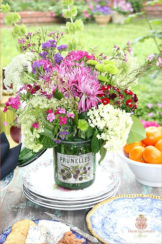 Spring-garden-flower-arrangement-in-French-antique-canning-jar-blue-white-tablesetting