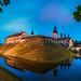 Nesvizh, Minsk Region, Belarus. Pnoramic View Of Niasviz Castle Or Nesvizh Castle In Evening Or Night Illuminations. Residential Castle Of Radziwill Family. UNESCO World Heritage Site