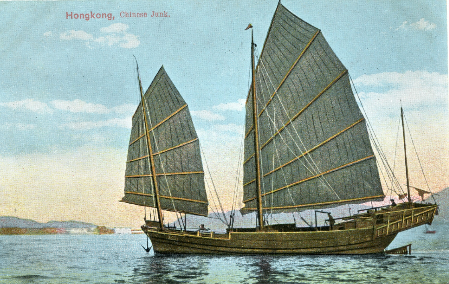 Postcard showing a junk in Hong Kong harbor.