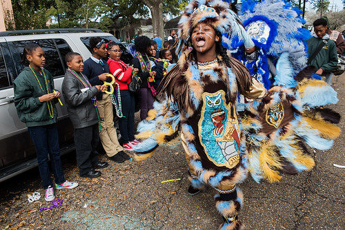 Wild Opelousas Big Queen Regine show her suit to classmates after months of work on Febuary 8, 2017. Photo by rhrphoto.com.