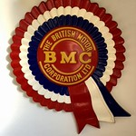 Fri, 2018-03-16 10:24 - Oddly this is one of my prized possessions! As a child I wrote to Longbridge and asked and was sent this fibreglass BMC rosette - the logo for the amalgamated Austin and Morris businesses that was formed in 1952. Over time the company, by then with other components such as Pressed Steel Fisher (their body producers) and Jaguar morphed into British Motor Holdings before the infamous 1968 merger with Leyland to produce the eventually fated British Leyland. Anyhow, this cheery rosette was used for marketing for many years and is synonymous with many British cars of the era - Austin, Morris, Riley, Wolseley, MG and other 'badge engineered' vehicles. It perhaps always stuck in my mind as, as a toddler in Edinburgh, there was a giant rosette on a gable end at Haymarket close to where we lived in Coates Gardens.