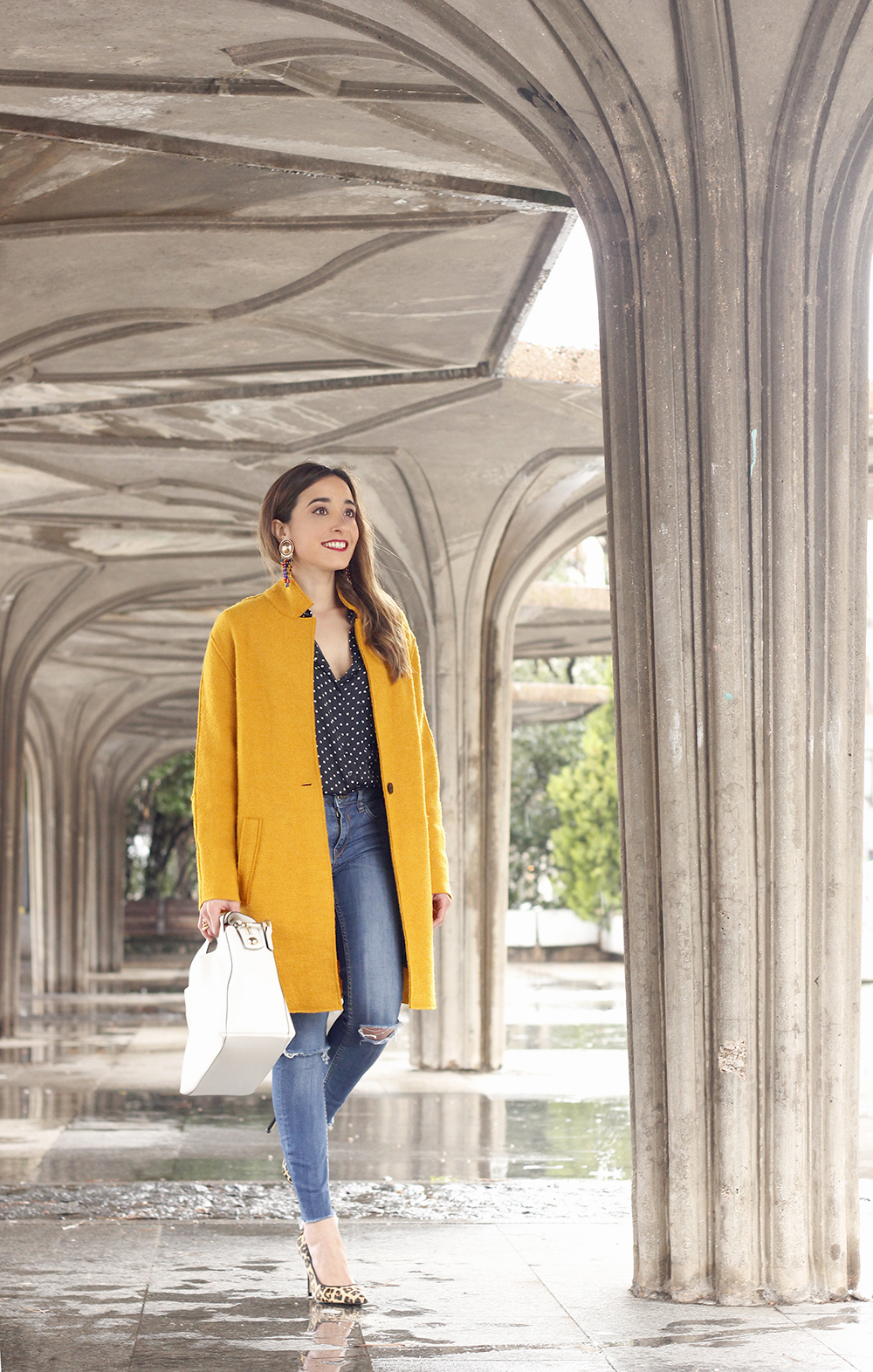 mustard coat polka dots shirt leopard heels white bag outfit 03