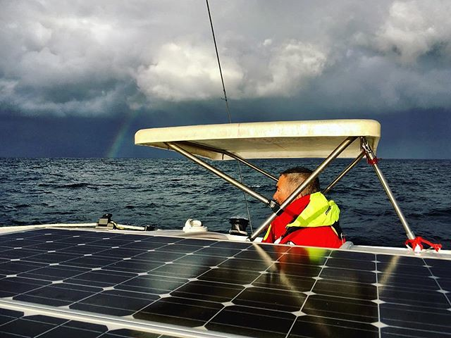 086/365 • here's M, hoping that those clouds are going to dump some rain on him so he can try out his new jacket... And check out the bimini he made while we were in Bayview - we've never had a roof while steering, it's a very welcome addition! • . #solar