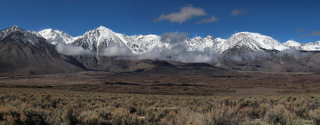 Eastern Sierra panorama of black lava and white snow