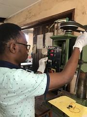 Team Nassali repairing the drill press