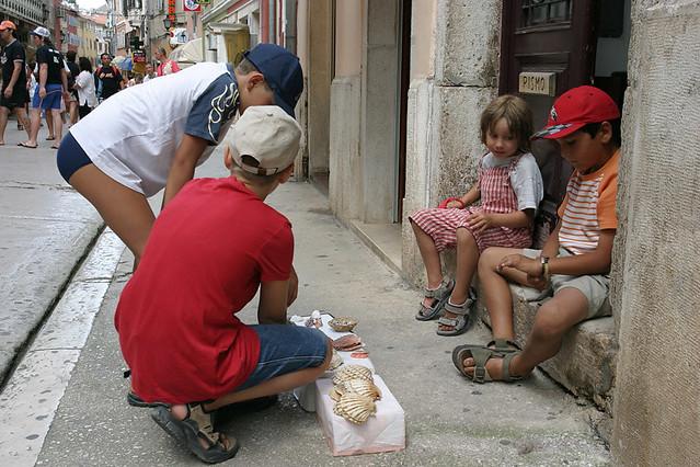 Kids selling shells in Croatia