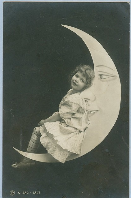 A girl relaxes on the moon postcard