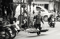Using a cell in Vietnam while driving a moped.