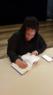 Angie Thomas signs my copy of The Hate U Give.