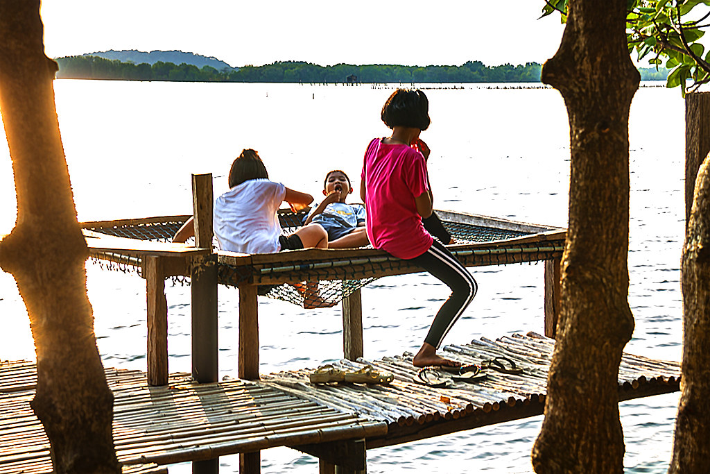 Kids at riverside restaurant--Chanthaburi