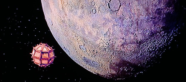 Cavor's spherical spaceship approaching the moon in