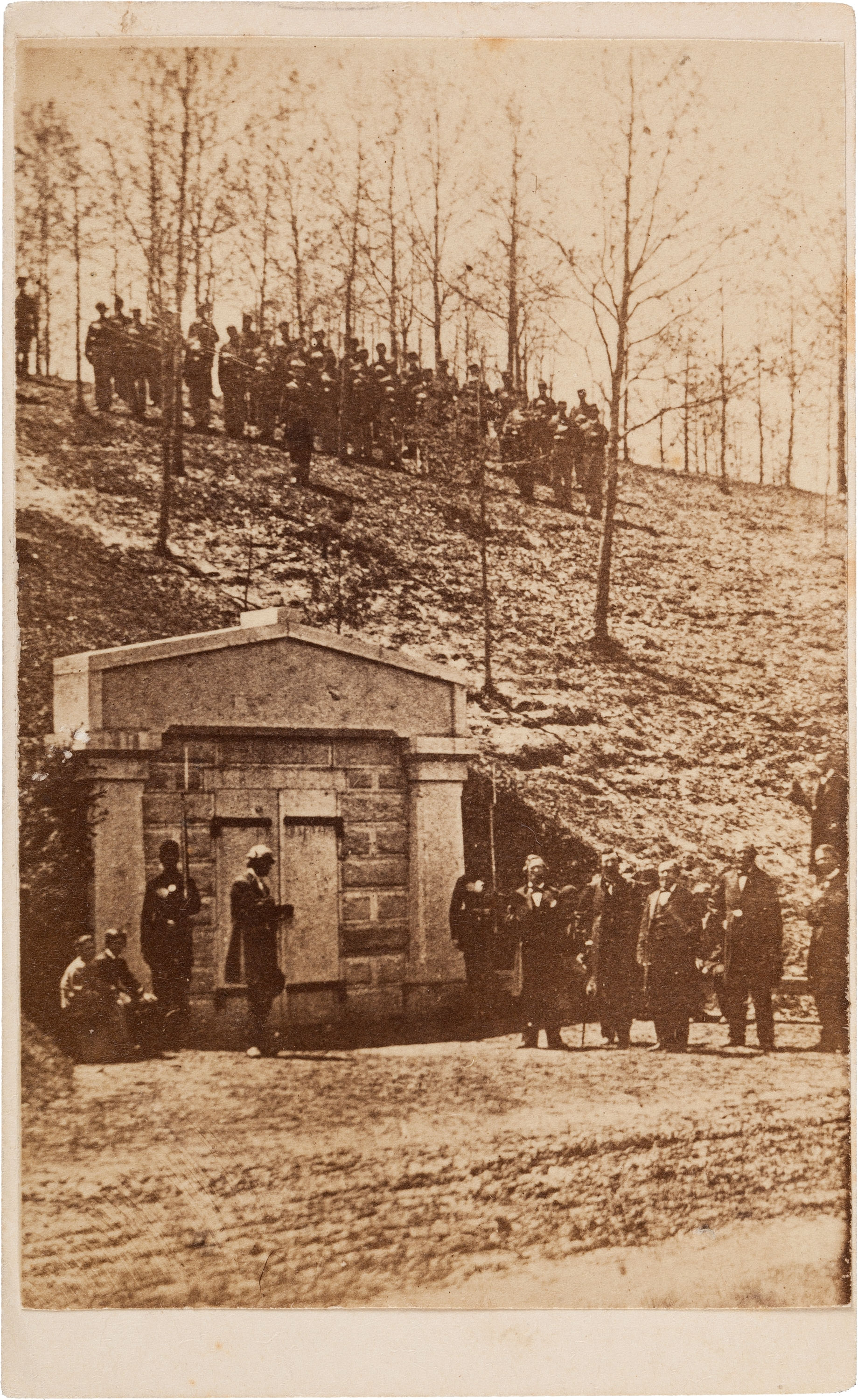 Carte-de-visite showing soldiers posted at the receiving vault at Oak Ridge Cemetery in Springfield. Five civilians, likely a committee of arrangements, stand to the right.