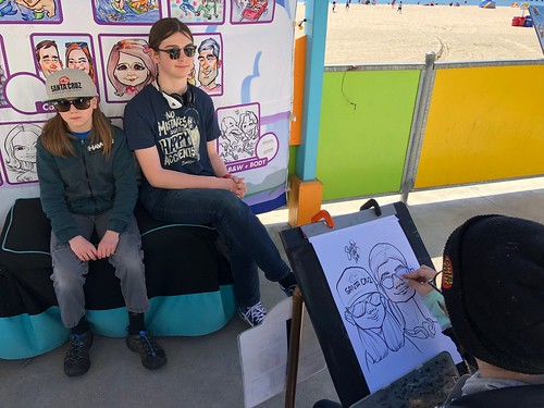 Nick & Sequoia posing for their caricature