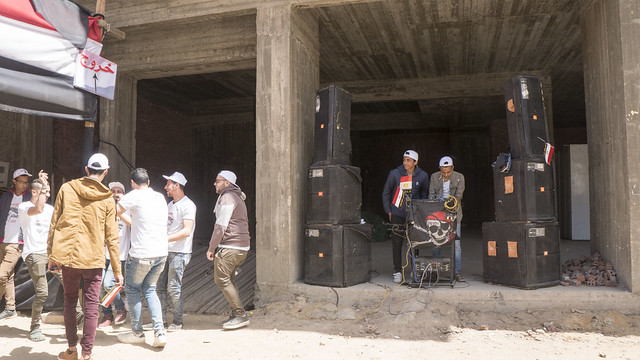 A local DJ outside a polling station in Egypt's Presidential elections