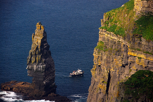 Ferry boat that travels underneath the Cliffs of Moher, Ireland