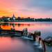 Nesvizh, Minsk Region, Belarus. Corpus Christi Church And Castle Near Pond Lake At Summer Sunset Evening Or Sunrise Morning. Famous Landmark In Nyasvizh