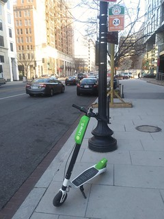 A Lime dockless electric scooter on 6th Street NW, Washington, DC