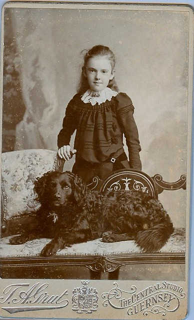 A girl with her pet dog posed handsomely