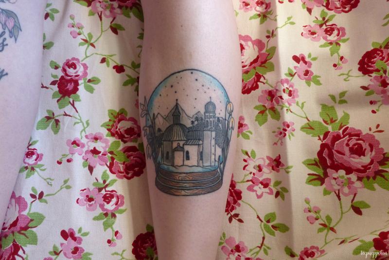 seefeld austria snow globe winter leg tattoo