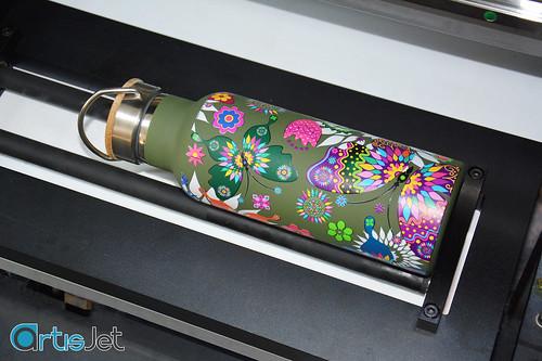 Printing on bottles with artis5000U