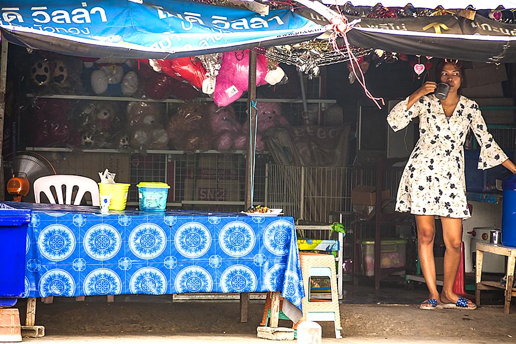 Woman inside shop--Thep Nimit