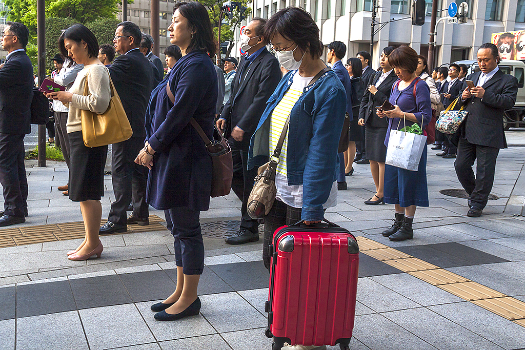 Office workers waiting to cross street in Nihombashi--Tokyo