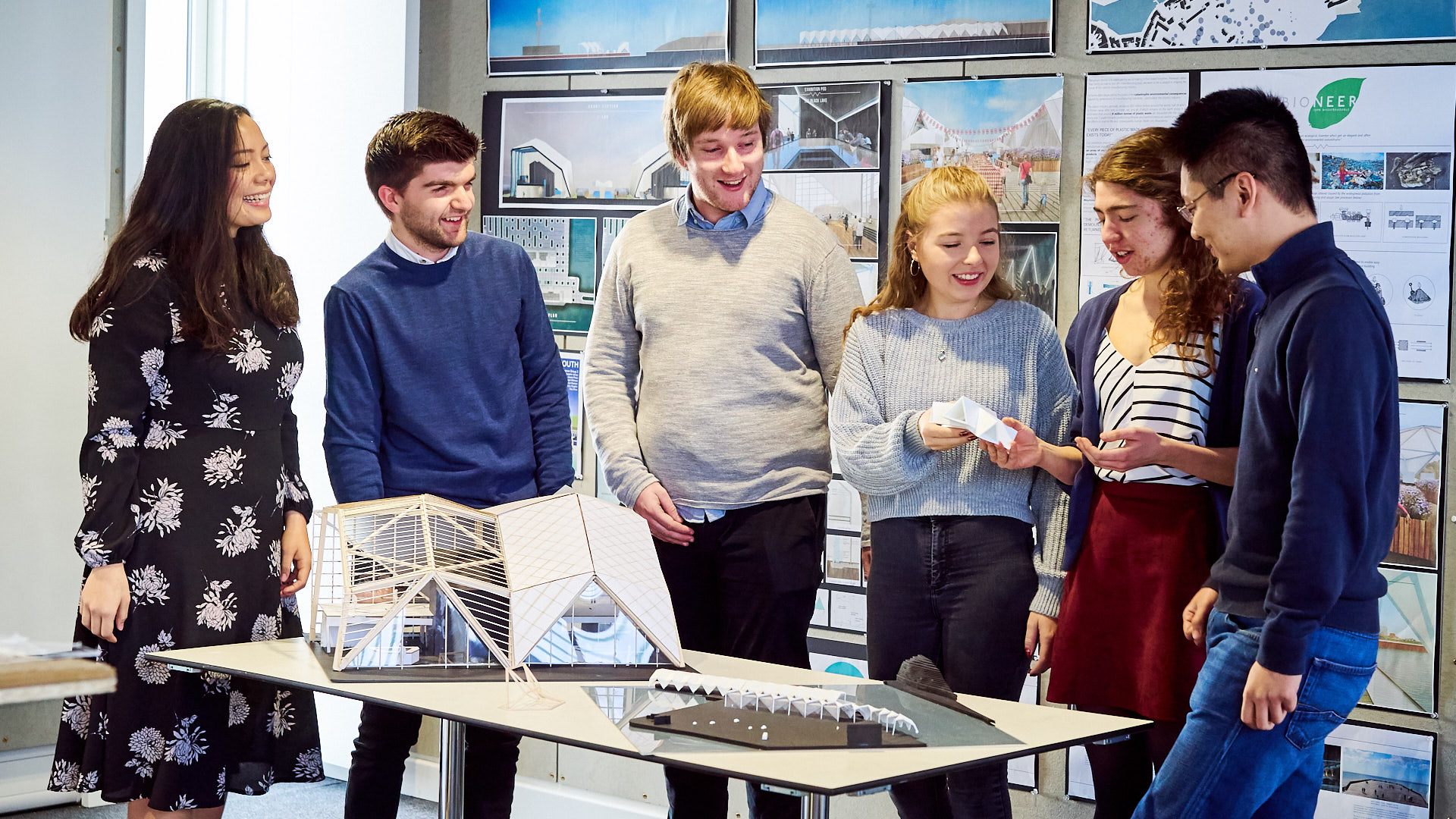 Students from group 2 of this year's Basil Spence competition discuss a model of their project to design a temporary exhibition pavilion for Weymouth