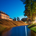 Nesvizh, Minsk Region, Belarus. View Of Niasviz Castle Or Nesvizh Castle And Moat In Evening Or Night Illuminations. Residential Castle Of Radziwill Family. UNESCO World Heritage Site