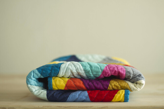 folded triangle baby quilt