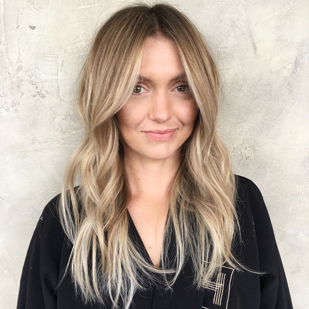 Wavy Layered Cut With Long Curtain Bangs And Soft Caramel