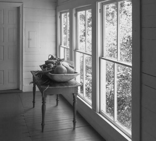 louisiana melroseplantation gourds table bw blackandwhite plantationhome windows door sunlight natchitochesparish porch summer