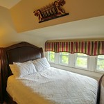 Queen size leather and wood bed.  Bed overlooks great street scene
