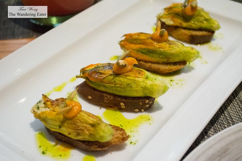 Fried baby zucchini flowers on toast