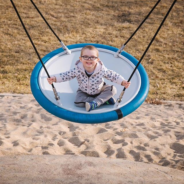 Ezra swinging happily. // #ezrayuuto #boystownliving