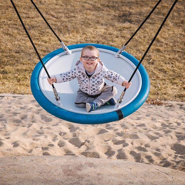 Ezra swinging happily. // #ezrayuuto #boystownliving