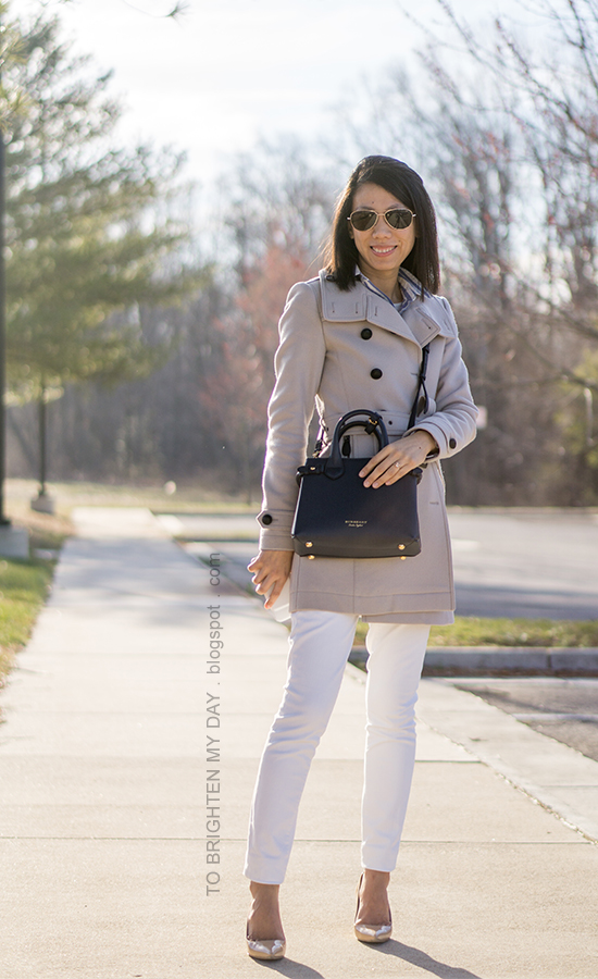 gray wool trench coat, navy crossbody bag with check pattern, blue striped shirt, white jeans, nude pumps