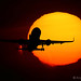 A320 crossing sun by Artyom Anikeev