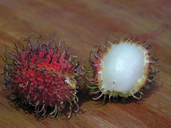 flower(0.0), plant(0.0), flora(0.0), produce(0.0), rambutan(1.0), macro photography(1.0), fruit(1.0), food(1.0),