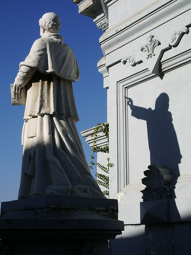 Priest statue makes a bunny shadow puppet