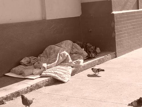 Homeless sleeping on the sidewalk
