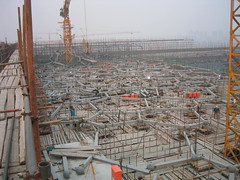mast(0.0), construction equipment(0.0), arena(0.0), reinforced concrete(1.0), construction(1.0), scaffolding(1.0),