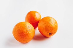 Group of three oranges on white background
