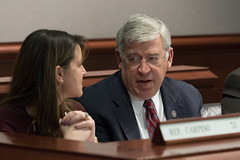 Rep. Storms discusses legislation with Rep. Carpino during a Judiciary Committee meeting