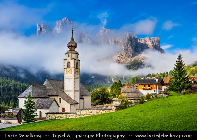 Italy - Alps - Dolomites - Colfosco Church with morning mist