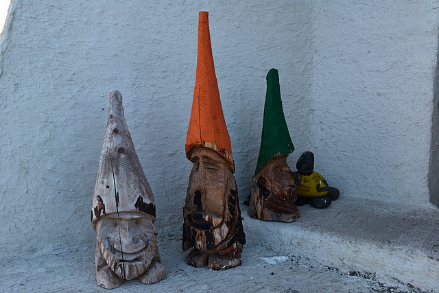 gnomes greet visitors to the lighthouse entrance
