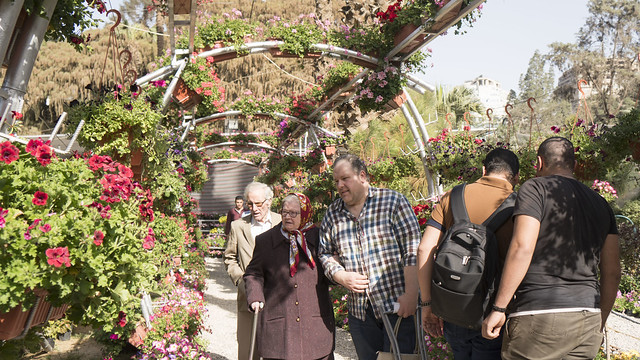 A family visiting Egypt's Spring Flowers Fair 2018