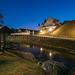 Nesvizh, Minsk Region, Belarus. View Of Niasviz Castle Or Nesvizh Castle In Evening Or Night Illuminations. Residential Castle Of Radziwill Family. UNESCO World Heritage Site